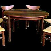 Stunning c1960 Mid-Century Modern Rosengren Hansen Solid Rosewood Round Dining Table w 2 Leave