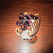 Large Purple Unfoiled Rhinestone,  Swirled Gold Tone Swirls Brooch