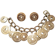 Napier Gold Tone Charm Bracelet and Earrings with Faux Chinese Coins