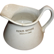 "Rucklos Brothers Deshler Nebraska cream, milk, water pitcher. 5"" semi-porcelain"