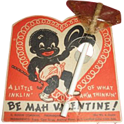 BLACK AMERICANA vintage Valentine from Valentine's Day complete with sucker wrapping and stick