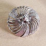 Lisner Silvertone Pinwheel Brooch