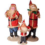 Three Santa Claus's