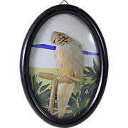 Oval-Framed Picture of a Parrot Made With Feathers