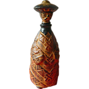Hand tooled leather and Glass figural flask/ decanter