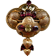 A Victorian 15ct Gold, Garnet and Chrysoberyl Brooch. Circa 1855.