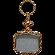 A Georgian Gold Cased Quizzing Glass. Circa 1825.