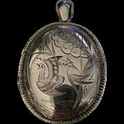 A Victorian Sterling Silver Locket. Circa 1885.