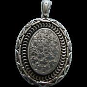 A Victorian Sterling Silver Locket. Circa 1881.