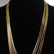 Anne Klein Gold-Tone Six Strand Serpentine Chain Necklace