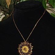 Gold-Tone and Rhinestone Sunburst Pendant