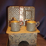 Antique German miniature embossed tin toy kitchen stove