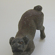 Antique metal miniature crouching brown dog