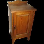Antique ash child's washstand cabinet