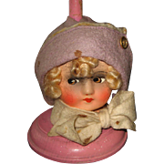 Antique German paper mache head hat stand pink with a large head