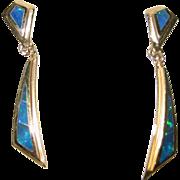One pair of 14K yellow gold & Black Opal dangle earrings
