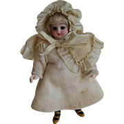 Antique miniature doll with bisque head blonde mohair wig
