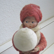 Antique German Heubach Googly eye candy container  sitting on a snowball