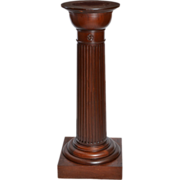Mahogany pedestal with fluted column and carvings.