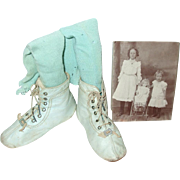 Old Baby Blue Childs Shoes With Socks & An Old Photo Of Two Girls With A Doll