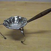 A fancy Swedish silver tea strainer circa 1851.