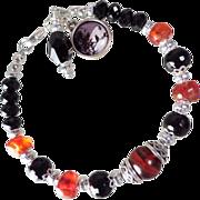 SOLD MORRIGAN Bracelet Red Amber Antique Faceted Amber Mineral Jet Celtic Raven Goddess