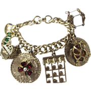 "Vintage Charm Bracelet with 8 Unique Jeweled Charms on a 7"" Goldtone Bracelet"