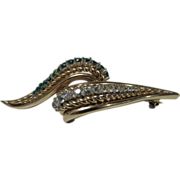 Vintage Boucher Signed and Numbered Swirl Pin Enhanced with Faux Emerald and Clear Crystals