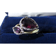14 Karat Yellow Gold Garnet and Diamond Bypass Ring