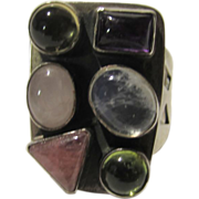 Sterling Silver Ring With a Variety of Stones Including Moonstone, Amethyst and Peridot