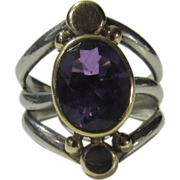Sterling Silver and 14 Karat Yellow Gold Ring With Bezel Set Oval Amethyst