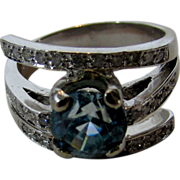 14 Karat White Gold Ring Of Natural Blue Zircon and Enhanced With Diamonds