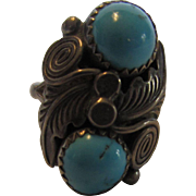 Sterling Silver Ring With Twin Turquoise Cabochons and Intricate Design
