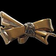 14 Karat Yellow Gold and Diamond Bow Pin