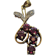 14 Karat White Gold Pendant Featuring Five Beautifully Matched Rubies With Diamond Accents