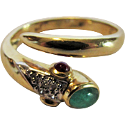 14 Karat Yellow Gold Serpent Ring With Emerald Cabochon Head and Two Sapphire Cabochon Eyes ..