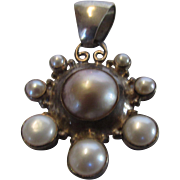 Sterling Silver Pendant With One Large Mabe Pearl and Cultured Pearl Surround
