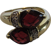 14 Karat Yellow Gold Garnet Ring with Diamond Accents