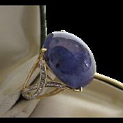 14 Karat Yellow Gold Tanzanite Ring With Diamond Accented High Set Band