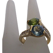 14 Karat Yellow Gold Blue Topaz and Peridot By Pass Ring Enhanced with Diamonds