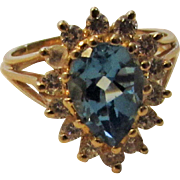 14 Karat Yellow Gold Diamond Blue Topaz Ring