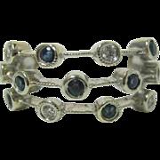 Blue and White Diamonds in Open 14 Karat White Gold Band
