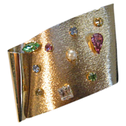 Vintage Fabulous Forties Gold-Plated Pin Decorated with  a Variety of Gem Tone Stones
