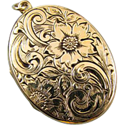 Vintage ornate chased floral engraved gold filled locket signed JM Fisher Company