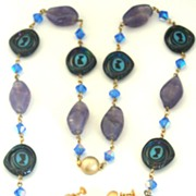 SALE Vintage Spinning Nefertiti Glass Bead Necklace and Clip Earrings Demi