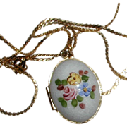 SALE White Enamelled Egg-shaped Locket with Hand Painted Flowers and Space for Two Photos