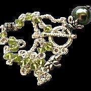 SOLD Tahitian Pearl bracelet South Sea Pearl Silver Peridot bracelet Peacock green Pearl Black