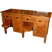 Unusual quartered oak work table with swing out seats