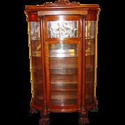 Quartered oak leaded curved glass china cabinet