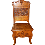 Quartered oak carved hall chair with lift lid